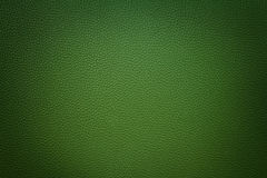 Green synthetic leather  background with vignette Stock Photography