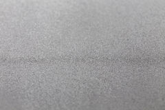 Grey silver metallic glitter shiny modern cold industrial textured background selective focus Stock Image