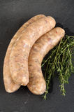 Grill sausage with herbs in natural casing Stock Photography