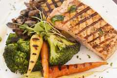 Grilled Pacific Coast salmon with grilled vegetables Stock Images