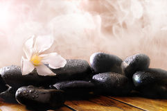 Group of black stones on wood base with steam background Royalty Free Stock Photo