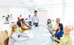 Group of Business People having a meeting in their Office Royalty Free Stock Images