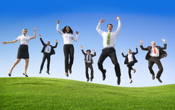 Group of Business People Jumping on the Hill Royalty Free Stock Images
