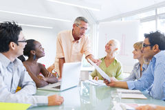 Group of Business People Learning With the Help of Their Mentor Stock Image