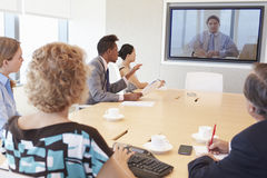 Group Of Businesspeople Having Video Conference In Boardroom Stock Photography