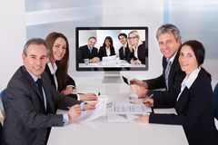 Group of businesspeople in video conference Stock Image