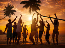 Group of Cheerful People Partying on a Beach Stock Image