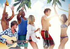 Group of Cheerful People Partying on a Beach Royalty Free Stock Photo