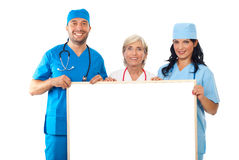 Group of doctors holding banner Stock Images