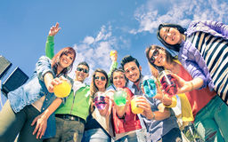 Group of happy friends having fun together at cocktail party Royalty Free Stock Photo
