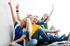 Group of happy students on a break waving Stock Photos