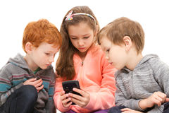 Group of kids using smartphone Royalty Free Stock Images