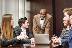 Group of multiethnic busy people working in an office Stock Photography