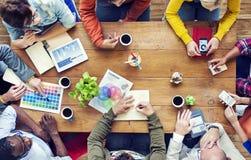Group of Multiethnic Designers Brainstorming Stock Image