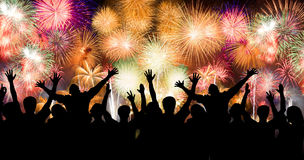 Group of people enjoying spectacular fireworks show in a carnival or holiday Royalty Free Stock Photos