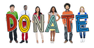 Group of People Holding Letter Donate Concepts Stock Photography