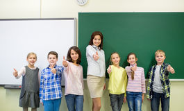 Group of school kids and teacher showing thumbs up Royalty Free Stock Photo