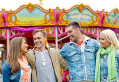 Group of smiling friends in amusement park Royalty Free Stock Image