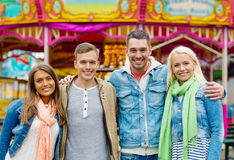Group of smiling friends in amusement park Royalty Free Stock Photos