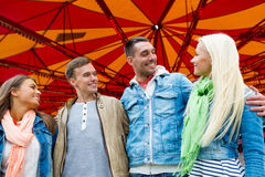 Group of smiling friends in amusement park Royalty Free Stock Images