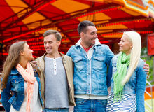 Group of smiling friends in amusement park Stock Photos