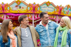 Group of smiling friends in amusement park Royalty Free Stock Photography