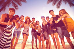 Group of smiling men and women showing thumbs up on beach Royalty Free Stock Photos