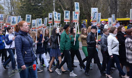 A group of an unidentified peoples with placards Royalty Free Stock Images