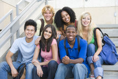 Group of university students sitting on steps Stock Photography
