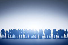 Group of various people looking towards light, future. Stock Photography