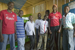 A group of young Kenyan males, who are affected with HIV/AIDS, pose for camera at Pepo La Tumaini Jangwani, HIV/AIDS Community Reh Stock Images