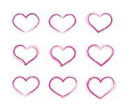 Grupo de símbolos retro do coração do vetor do grunge do garrancho Imagens de Stock Royalty Free
