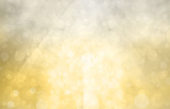 Guld- bakgrund för silver med ljust solsken på bokehcirklar eller bubblor i ljust vitt ljus Royaltyfria Foton