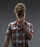 Guy that's done, close the face  his hand Royalty Free Stock Images