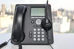 Hörlurar med mikrofon och IP-telefonen Royaltyfri Bild