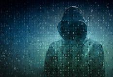 Hacker over a screen with binary code Stock Photos