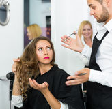 Haircutter quarrels with the client Stock Images