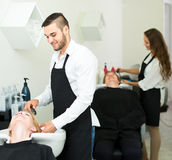 Hairstylist washing head of woman Royalty Free Stock Photo