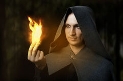 Halloween concept. Powerful Male witch Stock Images