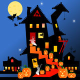 Halloween house and pumpkins. Royalty Free Stock Photo