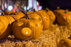 Halloween pumpkins at night on hay bale. Royalty Free Stock Photos