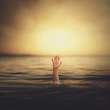 A hand coming out of the water Royalty Free Stock Photos