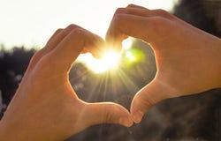 Hand heart sunshine Stock Photography