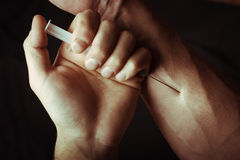 Hand with heroin syringe Royalty Free Stock Photography