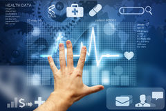 Hand touching screen with medical data Royalty Free Stock Images