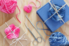 Handmade pink, blue crochet flowers and heart on gift Royalty Free Stock Photo