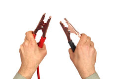 Hands with jumper cables on white Stock Photography
