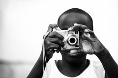 Hands on point and shoot camera Royalty Free Stock Photography