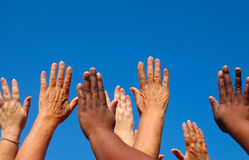 Hands raised together Stock Photography