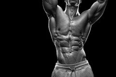 Handsome athletic man working out with dumbbells Royalty Free Stock Photos